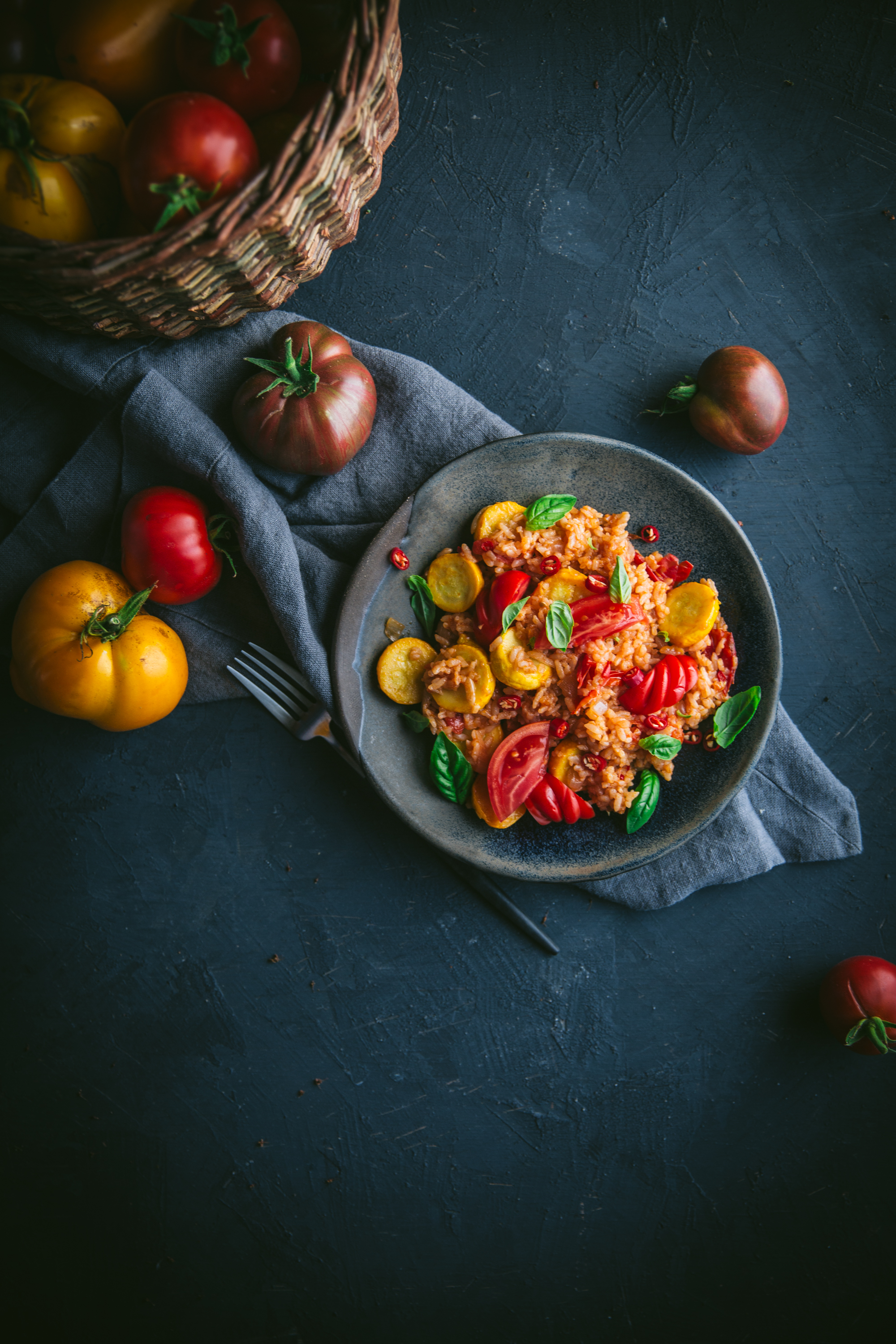 A delicious and easy summer squash and tomato stir fry with onions, garlic, rice, fresh basil, and chili. Recipe by Eva Kosmas Flores.
