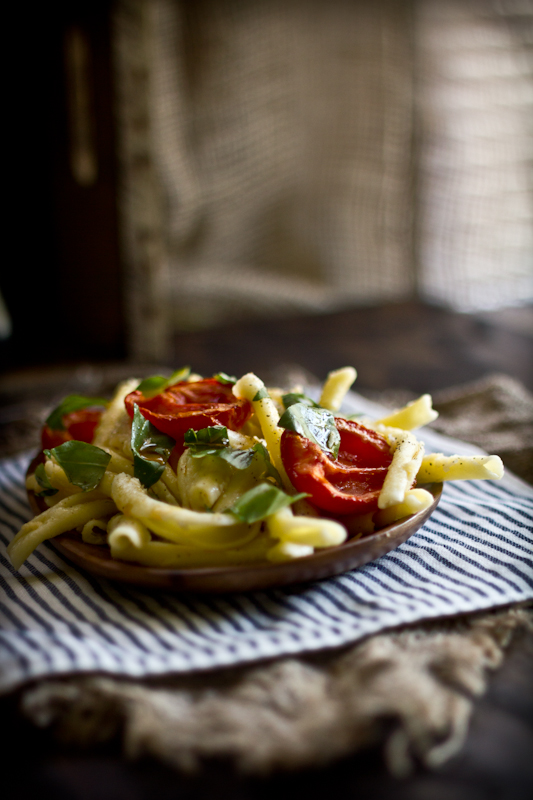 Strozzapreti Pasta with Fresh Basil, Roasted Tomatoes & Garlic, Toscano Cheese, & Harrisa Olive Oil