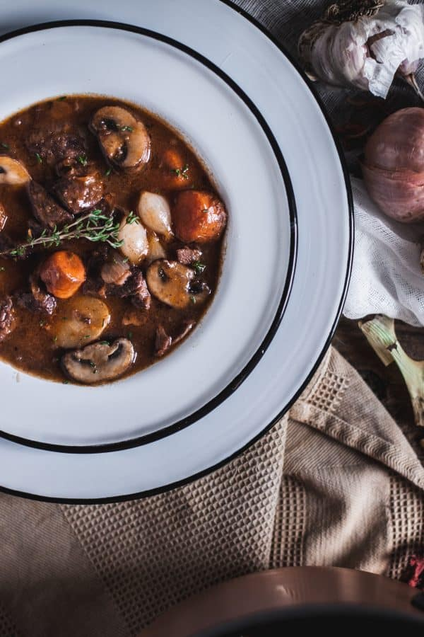 A recipe for Boeuf Bourguignon, a classic French country beef stew by Eva Kosmas Flores.