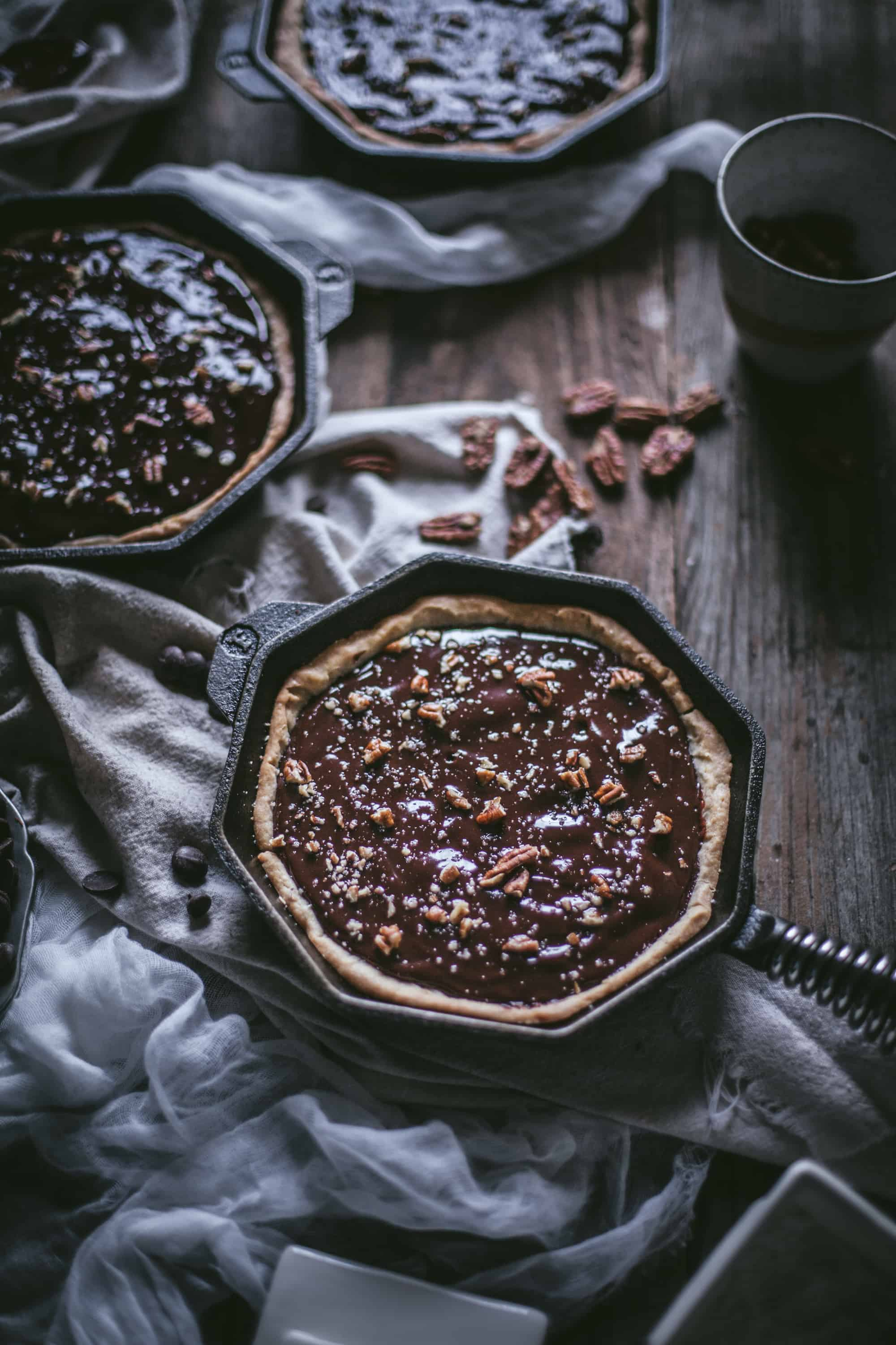 Cast Iron Deep Dish Chocolate Pecan Tart by Eva Kosmas Flores of Adventures in Cooking