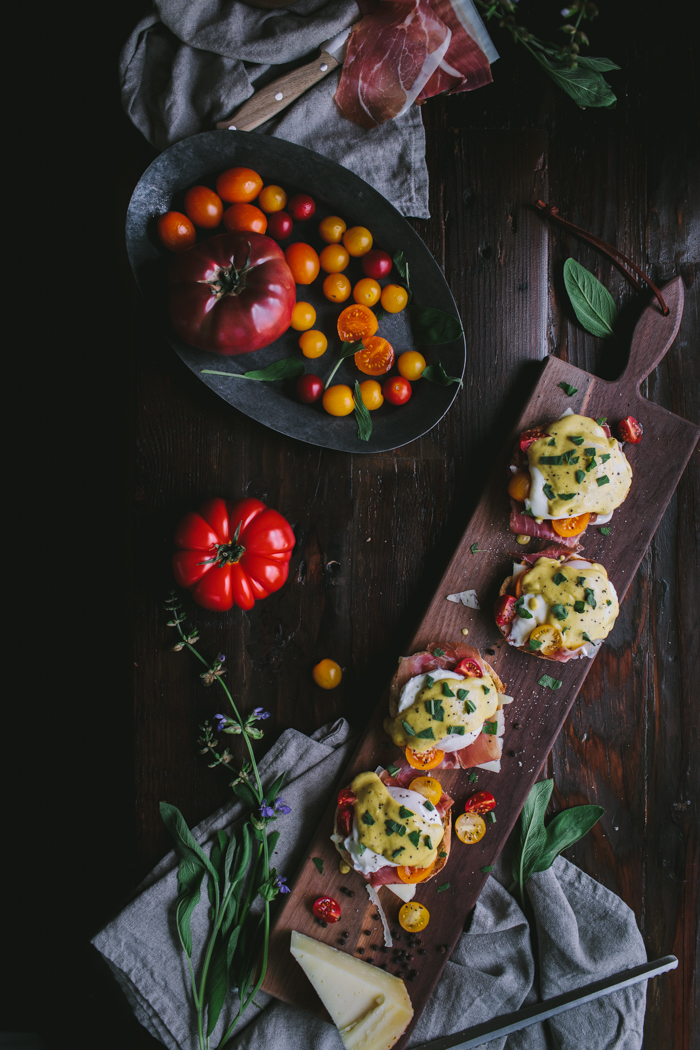 Eggs Benedict with Manchego, Tomatoes, Prosciutto & A Sage Hollandaise Sauce