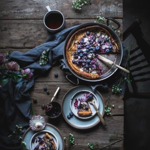 Blueberry Dutch Baby From the Cookbook 'First We Eat' by Eva Kosmas Flores