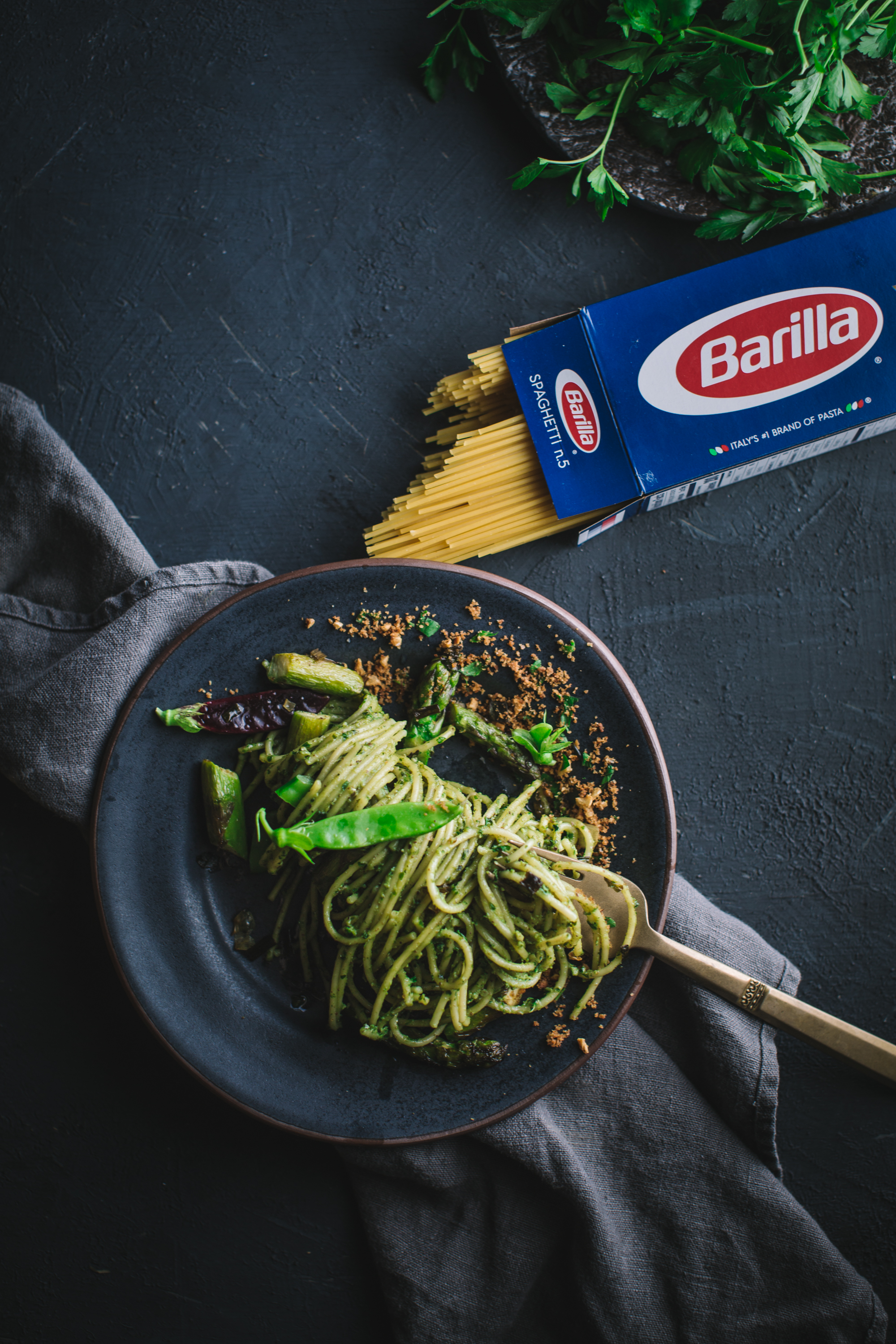 pasta, recipe, spaghetti, parsley, pestp, basil, walnuts, anchovies, asparagus, caramelized, spring, green, onion, snap, peas, barilla