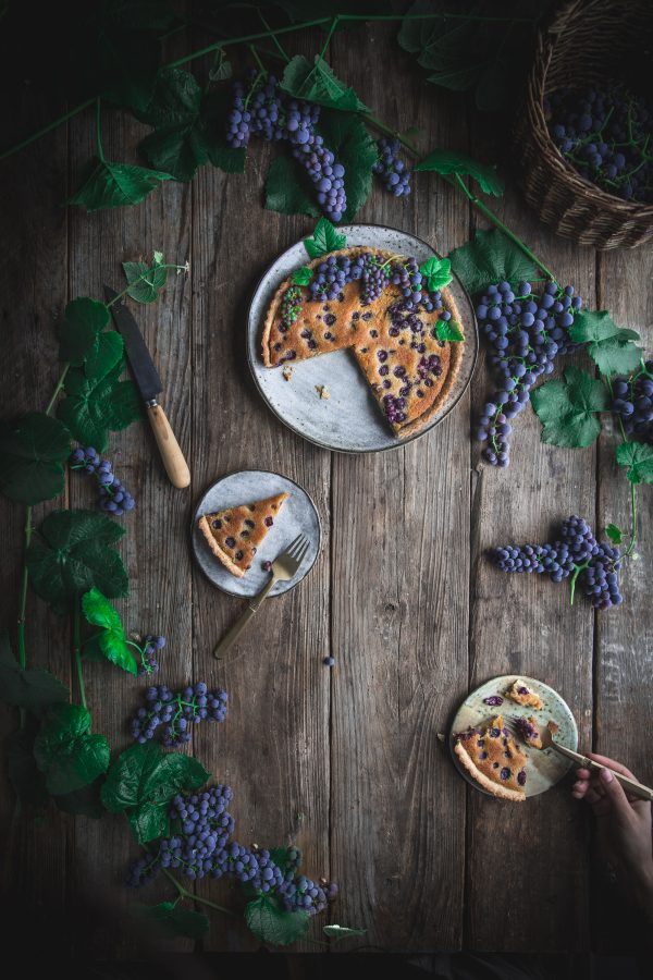 A delicious summer dessert recipe for a grape and almond tart with a buttery pastry crust.