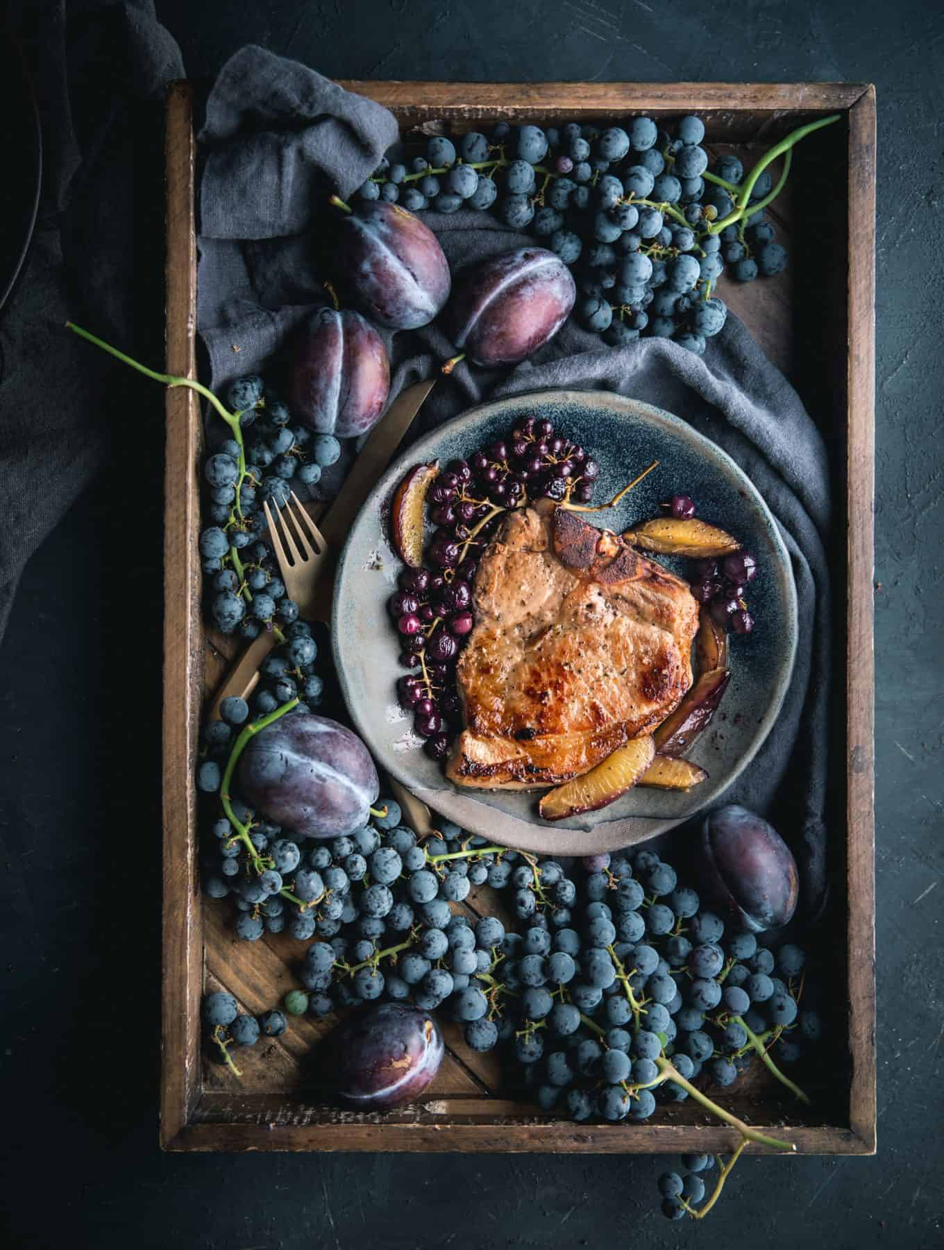 The Perfect Pork Chop with Roasted Grapes + Plums