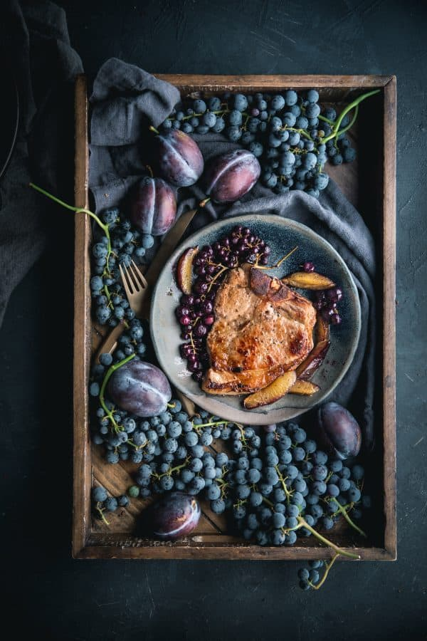 Perfect Brined Bone In Pork Chop with Roasted Grapes and Plums by Eva Kosmas Flores
